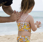Photo of sunscreen being applied to a child.